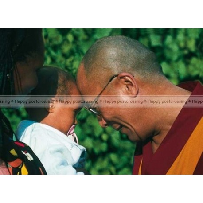 Dalai Lama greeting a child