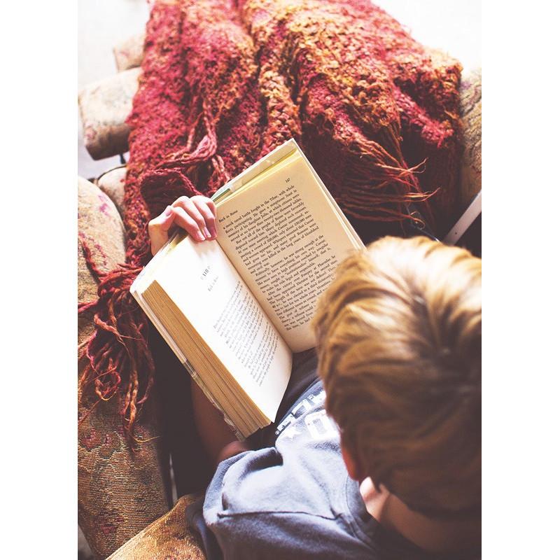 Reading under a blanket